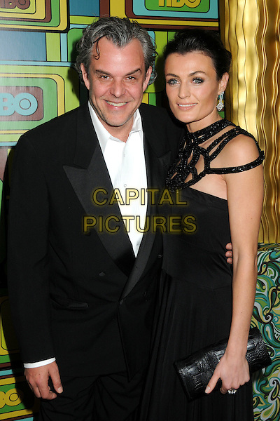 DANNY HUSTON & LYNE RENEE.HBO 2011 Post Golden Globe Awards Party held at The Beverly Hilton Hotel, Beverly Hills, California, USA..January 16th, 2011.half length black suit dress couple clutch bag.CAP/ADM/BP.©Byron Purvis/AdMedia/Capital Pictures.