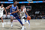 WINSTON-SALEM, NC - JANUARY 23: Wake Forest's Mitchell Wilbekin (10) and Duke's Wendall Carter, Jr. (34). The Wake Forest University Demon Deacons hosted the Duke University Blue Devils on January 23, 2018 at Lawrence Joel Veterans Memorial Coliseum in Winston-Salem, NC in a Division I men's college basketball game. Duke won the game 84-70.