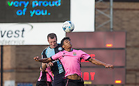 Darnell Furlong (Loanee from QPR) of Northampton Town beats Garry Thompson of Wycombe Wanderers in the air during the Sky Bet League 2 match between Wycombe Wanderers and Northampton Town at Adams Park, High Wycombe, England on 3 October 2015. Photo by Andy Rowland.