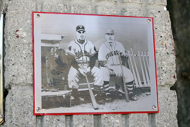 A picture of Bobo Brayton and Buck Bailey by the Cougar Baseball Wall of Honor, just inside the entrance to Bailey-Brayton Field, the baseball home of the Washington State Cougars baseball team, on the campus of Washington State University in Pullman, Washington.