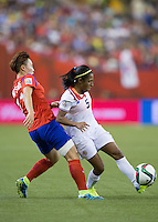 Montreal - June 13, 2015:  Costa Rica (white/red) tied with Korea (red/blue) 2-2  in a Women's World Cup match at the Olympic Stadium