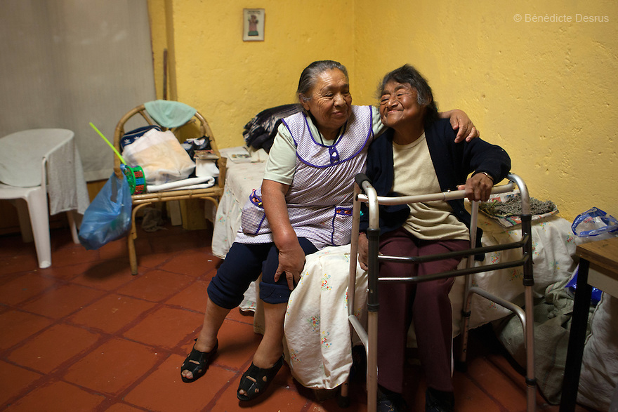 Conchita (L) and Carmelita (R), both residents of Casa Xochiquetzal, in their bedroom at the shelter in Mexico City, Mexico on April 20, 2012. Casa Xochiquetzal is a shelter for elderly sex workers in Mexico City. It gives the women refuge, food, health services, a space to learn about their human rights and courses to help them rediscover their self-confidence and deal with traumatic aspects of their lives. Casa Xochiquetzal provides a space to age with dignity for a group of vulnerable women who are often invisible to society at large. It is the only such shelter existing in Latin America. Photo by Bénédicte Desrus
