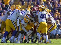 NWA Democrat-Gazette/BEN GOFF @NWABENGOFF<br /> David Williams, Arkansas running back, keep fighting forward through LSU defenders in the fourth quarter Saturday, Nov. 11, 2017 at Tiger Stadium in Baton Rouge, La.