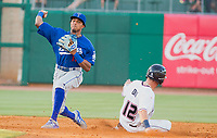 Tulsa Drillers vs NWA Naturals Baseball Erick Mejia of the Drillers tries to turn a double play as Nick Dini of the Naturals slides into second at Arvest Ballpark, Springdale, AR, Wednesday, July 12, 2017,  © 2017 David Beach