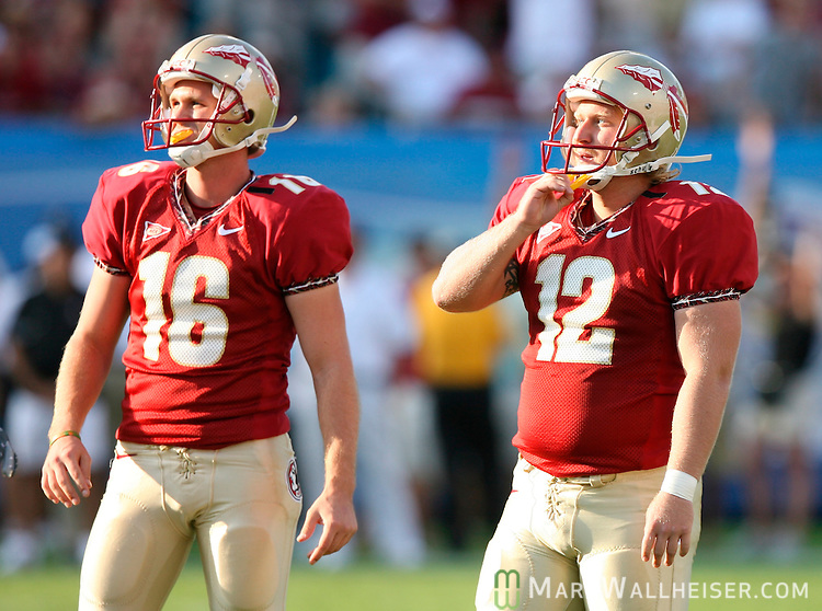 Kicker Gary Cismesia (12) and holder D'Vontrey Richardson watch Cismesia's field goal attempt in the first half miss in the game between the Florida State Seminoles and the University of Alabama Crimson Tide at Jacksonville Municipal Stadium in Jacksonville, Florida  September 29, 2007.    (Mark Wallheiser/TallahasseeStock.com)