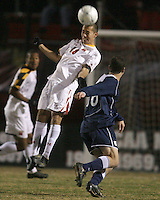 Alex Lee #18 of the University of Maryland heads away from Treavor Gelsinger #16 of Penn State during an NCAA 3rd. round match at Ludwig Field, University of Maryland, College Park, Maryland on November 28 2010.Maryland won 1-0.