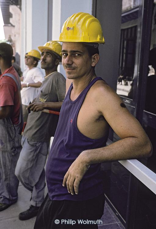 Telephone engineers take a break in Central Havana