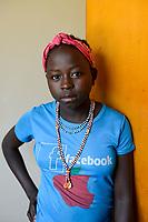 ETHIOPIA, Benishangul-Gumuz, Gumuz girl with facebook and apple logo on T-shirt / AETHIOPIEN, Provinz Benishangul-Gumuz, Stadt Gilgelbeles, Wohnheim fuer Gumuz Maedchen, Derbe Bake 13 Jahre