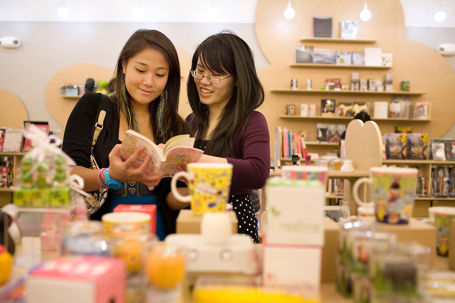 Shening Li, of Berkeley, left, and Michelle Shum, of San Francisco, right, check out Japanese books at New People retail shop, in Japantown, in San Francisco, Ca., on Saturday, May 29, 2010.