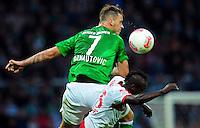 FUSSBALL   1. BUNDESLIGA   SAISON 2012/2013   4. SPIELTAG SV Werder Bremen - VfB Stuttgart                         23.09.2012        Marko Arnautovic (SV Werder Bremen) im Zweikampf mit Arthur Etienne Boka (VfB Stuttgart)  obenauf