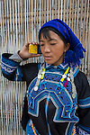 Hmong tribe woman using cellphone, Northern Vietnam