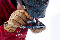 Colorado Avalanche Information Center (CAIC) Avalanche Forecaster Tim Brown (cq) uses a loop to look closely at large ice crystals found in  snow pack at Coon Hill, which stands about 11,150 feet in elevation, near Summit County in Colorado, Thursday, February 16, 2012. Tests at this area showed that there was a fairly hard slab of snow resting on weaker snow beneath making conditions which can lead to avalanches...Photo by Matt Nager