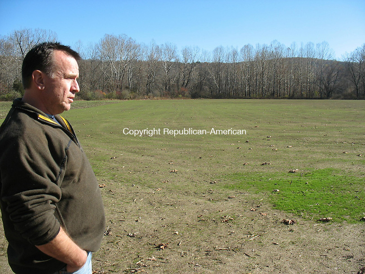 WOODBURY, CT - 11 November 2010 - 111110RH04 - Woodbury First Selectman Gerald D. Stomski overlooks the Strong Meadow Preserve, where workers planted 3,000 pounds of grass seed in anticipation of possibly creating athletic fields in the fall. Rick Harrison Republican-American