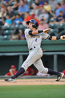 Shortstop Angel Aguilar (7) of the Charleston RiverDogs bats in a game against the Greenville Drive on Friday, August 14, 2015, at Fluor Field at the West End in Greenville, South Carolina. Charleston won 6-2. (Tom Priddy/Four Seam Images)