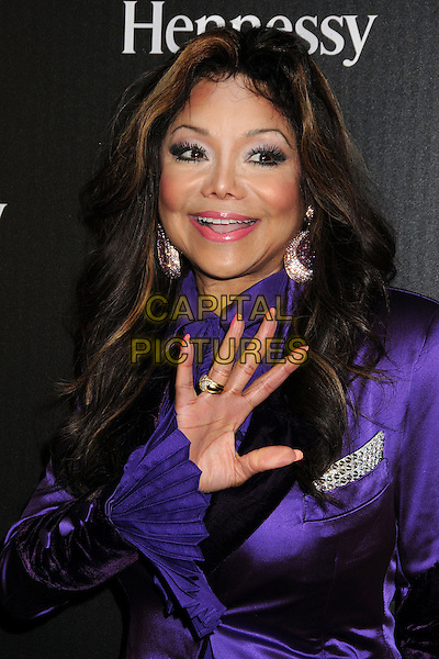 La Toya Jackson.Hennessy Toasts Achievements in Music with Grammy Host LL Cool J and Mark Burnett held at the SLS Hotel, Los Angeles, California, USA, .9th February 2013..portrait headshot  purple shirt suit jacket silk satin earrings hand waving .CAP/ADM/BP.©Byron Purvis/AdMedia/Capital Pictures.