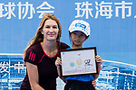 Steffi Graf of Germany, the global ambassador of Zhuhai WTA Elite Trophy 2017, poses for photo with child during the tennis clinic at plaza of Zhuhai International Convention and Exhibition Centre on November 04, 2017 in Zhuhai, China. Photo by Yu Chun Christopher Wong / Power Sport Images