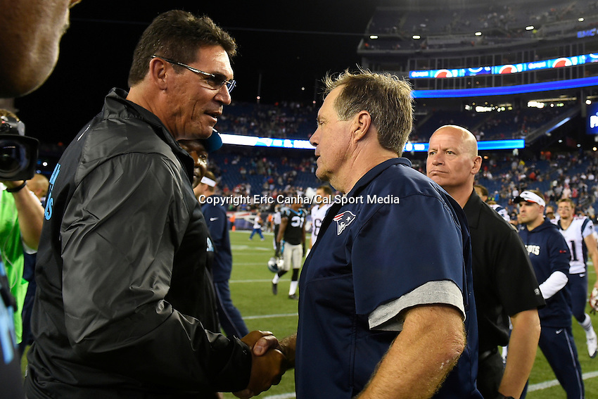 August 22, 2014 - Foxborough, Massachusetts, U.S.- Carolina Panthers head coach Ron Rivera (left) shakes hands with New England Patriots head coach Bill Belichick  (right) after the NFL game between the New England Patriots and the Carolina Panthers held at Gillette Stadium in Foxborough Massachusetts.  The Patriots defeated the Panthers 30-7. Eric Canha/CSM