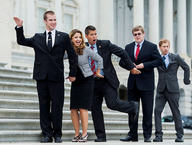 Rep. Sean Duffy, R-Wisc., center, poses for photos with interns and staff from his office on the House steps on Thursday, July 24, 2014.