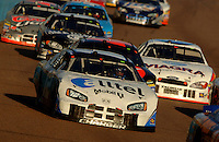 Nov 13, 2005; Phoenix, Ariz, USA;  Nascar Nextel Cup driver Ryan Newman driver of the #12 Alltel Dodge leads a pack of cars during the Checker Auto Parts 500 at Phoenix International Raceway. Mandatory Credit: Photo By Mark J. Rebilas