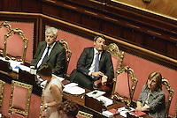 Roma, 24 Giugno 2014<br /> Il Presidente del consiglio Matteo Renzi nell'Aula del Senato per le comunicazione sul semestre europeo.<br /> I banchi del Governo, Renzi indica l'ora.<br /> Rome, June 24, 2014 <br /> The italian Premier , Matteo Renzi in the Senate for communication on the European Semester