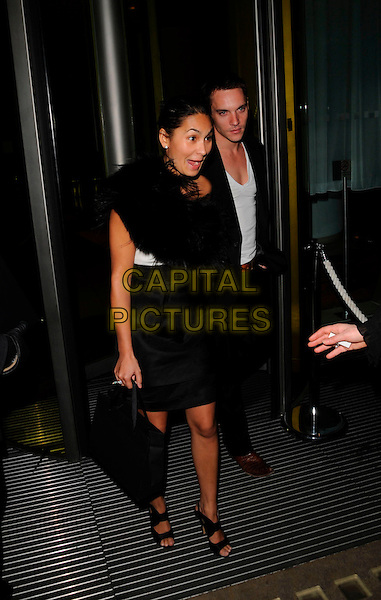 "REENA HAMMER & JONATHAN RHYS MEYERS .Attends ""Not Another Burns Night"" Charity Dinner in aid of Clic Sargent Appeal held at the St Martins Lane Hotel, London, England, March 3rd 2008 full length black dress skirt funny mouth open.CAP/CAN.?Can Nguyen/Capital Pictures"