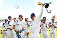 Picture by Alex Whitehead/SWpix.com - 12/09/2014 - Cricket - LV County Championship Div One - Nottinghamshire CCC v Yorkshire CCC, Day 4 - Trent Bridge, Nottingham, England - Yorkshire's Gary Balance celebrates with the trophy.
