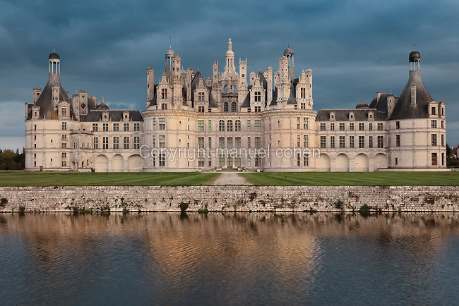 Northwest facade of the Chateau de Chambord, designed by Domenico da Cortona and built 1519-47 in French Renaissance style under King Francois I, at Chambord, Loir-et-Cher, France. The largest of the Loire Valley chateaux, Chambord has a central keep with 4 bastion towers on the corners, a moat and an elaborate decorative roofline. The chateau was listed as a UNESCO World Heritage Site in 1981. Picture by Manuel Cohen