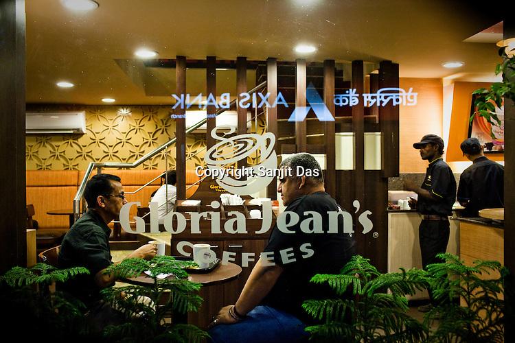 Guests enjoy coffee at a cafe at Vasant Vihar market complex in New Delhi, India  Photograph: Sanjit Das/Panos
