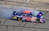 Sept. 27, 2008; Kansas City, KS, USA; NASCAR Nationwide Series driver Kyle Busch after crashing during the Kansas Lottery 300 at Kansas Speedway. Mandatory Credit: Mark J. Rebilas-