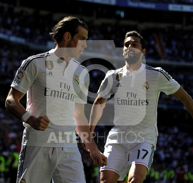 Real Madrid´s Gareth Bale and Alvaro Arbeloa celebrates a goal during 2014-15 La Liga match between Real Madrid and Granada at Santiago Bernabeu stadium in Madrid, Spain. April 05, 2015. (ALTERPHOTOS/Luis Fernandez)