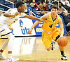 Thomas Ammendola #4 of Massapequa, right, gets pressured by Elijah Bovell #23 of Baldwin during the Nassau County varsity boys basketball Class AA semifinals at Hofstra University on Tuesday, Feb. 23, 2016. Top-seeded Baldwin had a 23-21 lead at halftime.