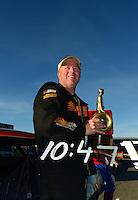 Oct. 28, 2012; Las Vegas, NV, USA: NHRA super stock driver Dan Fletcher celebrates after winning the Big O Tires Nationals at The Strip in Las Vegas. Mandatory Credit: Mark J. Rebilas-
