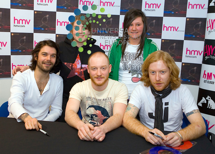 "Biffy Clyro come from playing to the MPs in Parliament to playing to the people at the MHV store in Buchanan Street in Glasgow.  Promoting their new single ""Many of Horror"", Simon Neil, James Johnston and Ben Johnston entertain the crowd before a signing session with fans...Picture: Peter Kaminski/Universal News and Sport (Scotland)"