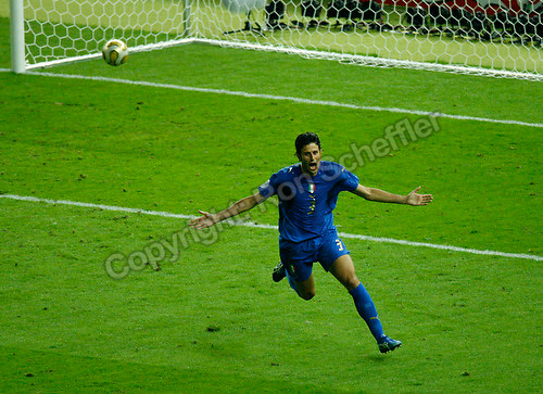 Jul 9, 2006; Berlin, GERMANY; Italy defender (3) Fabio Grosso celebrates his game ending penalty kick goal against France in the final of the 2006 FIFA World Cup at the Olympiastadion, Berlin. Italy defeated France 5-3 on penalty kicks following a 1-1 draw after extra time. Mandatory Credit: Ron Scheffler-US PRESSWIRE Copyright © Ron Scheffler