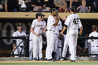Wake Forest Demon Deacons relief pitcher Griffin Roberts (43) is greeted by his teammates after getting the final out of an inning against the West Virginia Mountaineers in Game Four of the Winston-Salem Regional in the 2017 College World Series at David F. Couch Ballpark on June 3, 2017 in Winston-Salem, North Carolina.  The Demon Deacons walked-off the Mountaineers 4-3.  (Brian Westerholt/Four Seam Images)