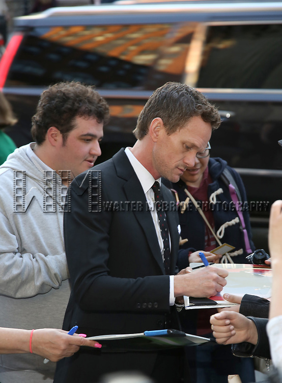 Neil Patrick Harris, signing autographs, attends the Opening Night 'In & Of Itself' at the Daryl Roth Theatre on April 12, 2017 in New York City