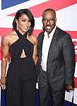 HOLLYWOOD, CA - MARCH 01: Actors Angela Bassett (L) and Courtney B. Vance attend the premiere of Focus Features' 'London Has Fallen' held at ArcLight Cinemas Cinerama Dome on March 1, 2016 in Hollywood, California.