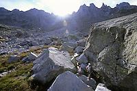 Bouldering in the shadow of Sciora Dafora (3169 m) and Ago di Sciora (3205 m), Bergell, Switzerland, August 2011.