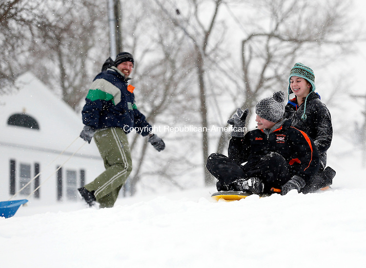 """Middlebury, CT- 02 February 2015-020215CM06-  Hannah Mehlin, 14,  of Watertown, throws up a """"peace sign"""" to her dad, Kirk Mehlin, as she sleds down Shepardson Hill with friend Emily Gurksy,14, in Middlebury on Monday.  Christopher Massa Republican-American"""