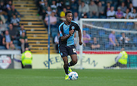 Jason Banton of Wycombe Wanderers in action during the Sky Bet League 2 match between Wycombe Wanderers and Plymouth Argyle at Adams Park, High Wycombe, England on 12 September 2015. Photo by Andy Rowland.