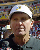 "Washington Redskins head coach Steve Spurrier is interviewed following his team's opening day 31 - 23 victory over the Arizona Cardinals at Fed Ex Field on Sunday, September 8, 2002.  It was Spurrier's first game as head coach and marked the debut of his ""Fun and Gun"" offense.  <br /> Credit: Arnie Sachs / CNP"