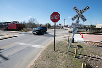 NWA Democrat-Gazette/J.T. WAMPLER A vehicle crosses the railroad tracks on Meadow St. in Springdale Wednesday March 7, 2018. The city is considering closing the crossing which is just south of the train depot on Emma Ave.