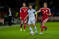 Wednesday 4th  December 2013 Pictured: Canstantinos Makridis of Cyprus plays the ball past Chris Gunter of Wales  and David Edwards of Wales <br /> Re: UEFA European Championship Wales v Cyprus at the Cardiff City Stadium, Cardiff, Wales, UK