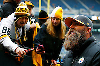 Brett Keisel signs autographs for fans prior to the game between the Pittsburgh Steelers and the Seattle Seahawks at CenturyLink Field on November 29, 2015 in Seattle, Washington. (Photo by Jared Wickerham/DKPittsburghSports)