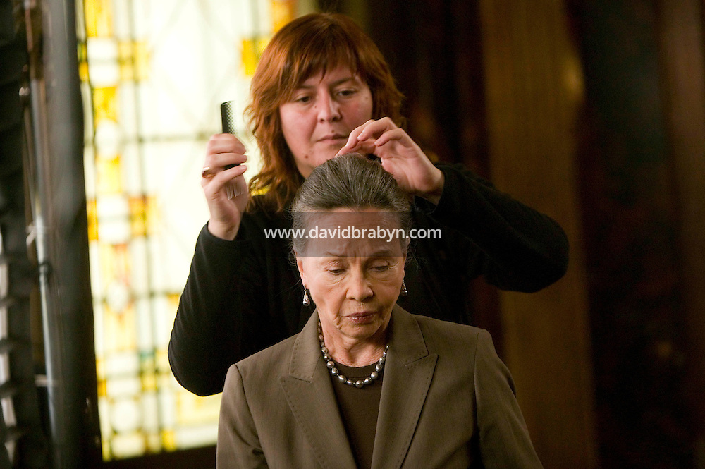 "8 May 2006 - North Bergen, NJ - French actress Leslie Caron (foreground) gets her hair retouched on the studio set of television show ""Law & Order: SVU"" in North Bergen, USA, 8 May 2006. In this rare appearance in front of American television cameras, Caron, 74, plays a French victim of past sexual molestation in an episode entitled ""Recall"" due to air in the fall. Caron starred in Hollywood classics such as ""An American in Paris"" (1951), ""Lili"" (1953), ""Gigi"" (1958). More recently she appeared in ""Chocolat"" (2000) and ""Le Divorce"" (2003). Photo Credit: David Brabyn"