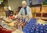 STAFF PHOTO JASON IVESTER --11/13/2014--<br /> Volunteers Martha Ringger (cq) (left) and Patsy White, both of Rogers, gather and bag food for visitors to the food pantry on Thursday, Nov. 13, 2014, inside Grace United Methodist Church in Rogers.
