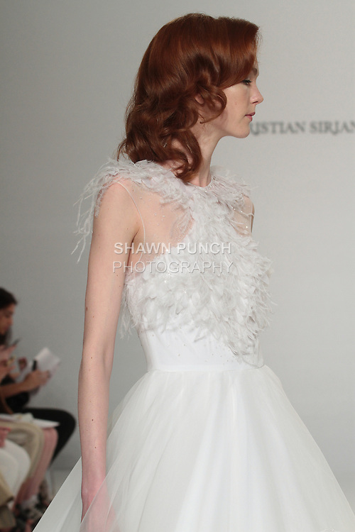 Model walks runway in a feather appliqué ball gown, from the Christian Siriano for Kleinfeld bridal collection, at Kleinfeld on April 18, 2016 during New York Bridal Fashion Week Spring Summer 2017.