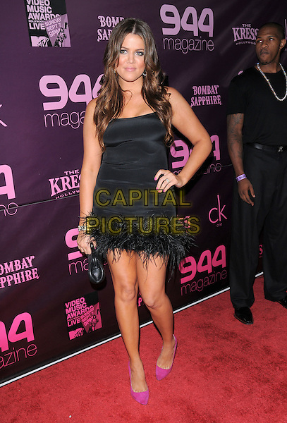 KHLOE KARDASHIAN .The 944 Magazine 2nd Anniversary & Official MTV VMA Week Party held at The Kress in Hollywood, California on .September 3rd, 2008                                                                     .full length black dress feathers pink shoes hand on hip .CAP/DVS.©Debbie VanStory/Capital Pictures.