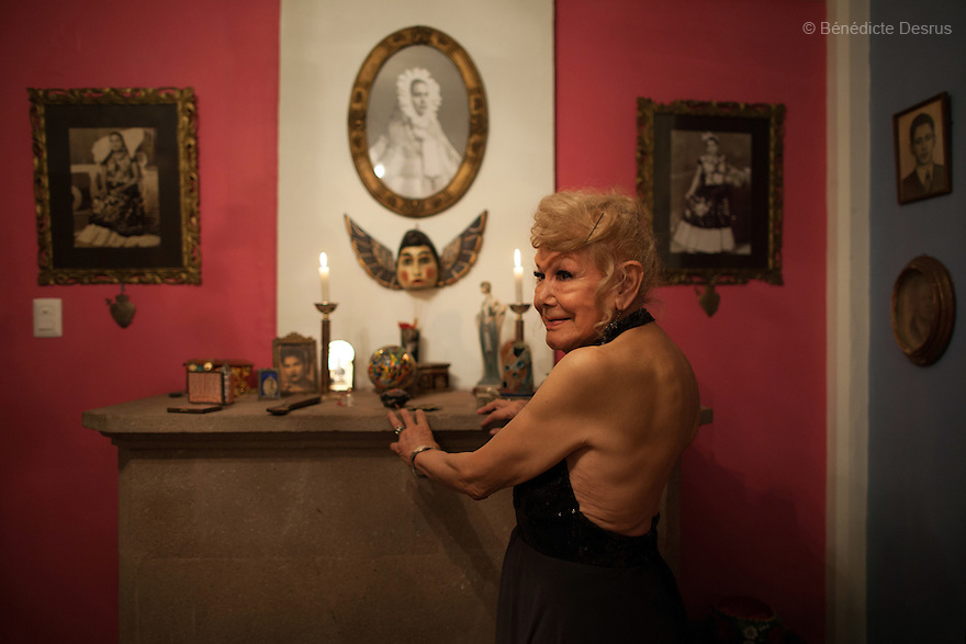 "August 8, 2015 - Mexico, Mexico City - Samantha celebrates her baptism at her friend Tico's house, along with other close friends. Samantha Flores is an 83-year-old transgender woman from Veracruz, Mexico. She is a prominent social activist for LGBTQI rights and is the founder of the non-profit organization ""Laetus Vitae"", a day shelter for elderly gay people in Mexico City. Senior citizens in general are many times prone to neglect and abandonment by their families, leaving them all but invisible. Their plight can be even worse if they are homosexual. Photo credit: Bénédicte Desrus"