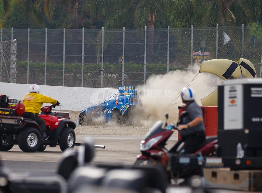 Nov 12, 2017; Pomona, CA, USA; NHRA funny car driver Tommy Johnson Jr goes into the sand trap during the Auto Club Finals at Auto Club Raceway at Pomona. Mandatory Credit: Mark J. Rebilas-USA TODAY Sports